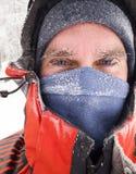 Frozen man face in winter scene. Frozen man face with blue eyes in winter scene Stock Photo