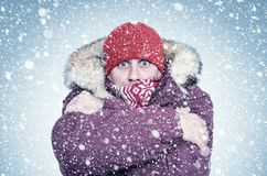Free Frozen Man In Red Winter Clothes Warms His Hands, Cold, Snow, Frost, Blizzard Stock Image - 160624361