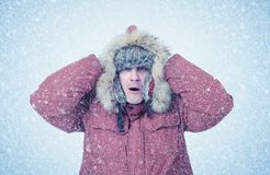 Frozen man in winter clothes, cold, snow, blizzard Royalty Free Stock Image
