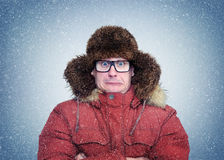 Frozen man in winter clothes and glasses, cold, snow, blizzard royalty free stock images