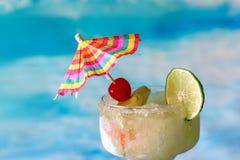 Frozen margarita with umbrella garnish stock photography