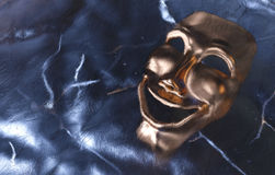 Frozen Mask. Theatrical mask frozen in ice. Concept picture Stock Images