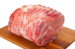 Frozen meat. Frozen pork chops on a white background royalty free stock images