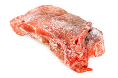 Frozen meat. Frozen pork meat on bright background royalty free stock images