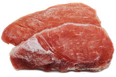 Frozen meat. Two slice frozen meat isolated on white Stock Photography