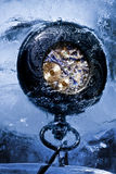 Frozen mechanical watch in ice Royalty Free Stock Photo
