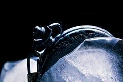Frozen mechanical watch in ice Stock Photo