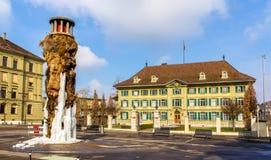 Frozen Meret Oppenheim Fountain and Police office in Bern. Switzerland stock photo