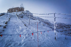 Frozen meteorological station in the mountains in winter Stock Photography