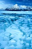 Frozen methane bubbles. In lake ice and snow covered mountains Stock Photography