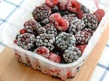 Frozen mixed berries close up. Stock Photos