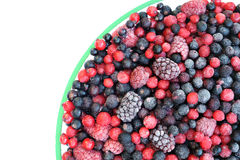 Frozen mixed fruit in bowl - berries. Red currant, cranberry, raspberry, blackberry, bilberry, blueberry, black currant Stock Images