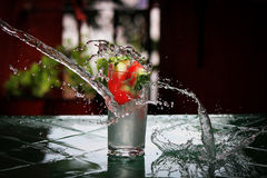 Frozen moment. Drink in a glass splashed with water stock image