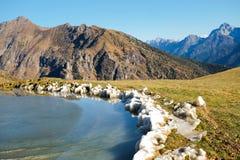 Frozen montain lake Stock Photos