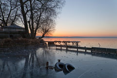 Frozen mooring. The mooring for small boats held down ice Royalty Free Stock Image