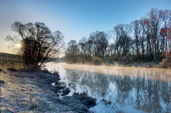 Frozen morning landscape with a river Royalty Free Stock Image