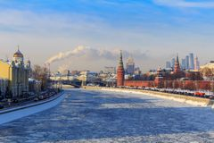 Frozen Moskva river on the background of Kremlevskaya embankment. Winter in Moscow Royalty Free Stock Image