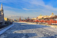 Frozen Moskva river on the background of Moscow Kremlin on a sunny winter morning Stock Photos