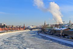 Frozen Moskva river on the background of Sofiyskaya embankment. Moscow in winter Royalty Free Stock Photo