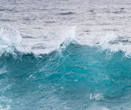 Frozen motion of ocean waves off Hawaii. Cresting ocean waves frozen with high shutter speed to show the individual droplets of water in the surf Royalty Free Stock Photos