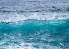 Frozen motion of ocean waves off Hawaii. Cresting ocean waves frozen with high shutter speed to show the individual droplets of water in the surf Stock Photo