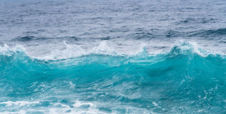 Frozen motion of ocean waves off Hawaii. Cresting ocean waves frozen with high shutter speed to show the individual droplets of water in the surf Royalty Free Stock Photo