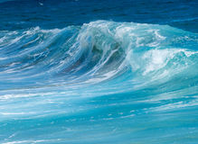 Frozen motion of ocean waves off Hawaii. Cresting ocean waves taken with high shutter speed to show droplets of water in the surf Stock Image