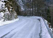 Frozen mountain road in winter stock photography