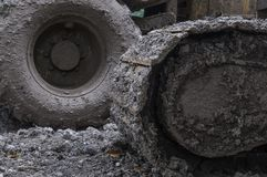 Frozen mud on heavy machinery wheels. Frozen mud on the wheels of  heavy machinery on a building site Royalty Free Stock Images