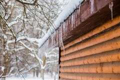 Free Frozen Mysterious Mansion With Water Pipe Gutters And Frozen Icicles On The Roof, Top Floor Wooden Mansion. Icy Weather Winter Royalty Free Stock Photo - 163499715