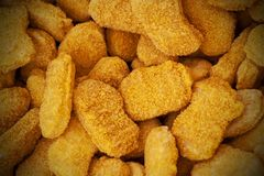 Frozen nuggets spread out evenly as a background. royalty free stock photo