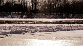 Frozen neris river in winter and floe floating sun reflections stock footage
