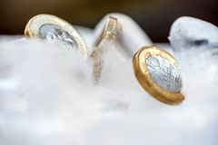 Frozen New British one pound sterling coin up close macro inside ice cubes.  Royalty Free Stock Image