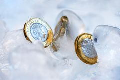 Frozen New British one pound sterling coin up close macro inside ice cubes.  Stock Images