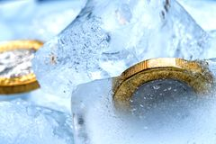 Frozen New British one pound sterling coin up close macro inside ice cubes.  Royalty Free Stock Images