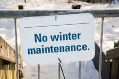Frozen No Winter Maintenance Sign on a Gate Royalty Free Stock Images
