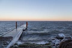 Frozen ocean pier Stock Images