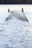 Frozen old pier at winter morning Royalty Free Stock Photo