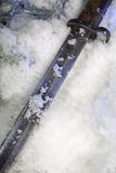 Frozen old trench knife Royalty Free Stock Photo