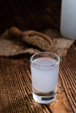 Frozen Ouzo in a shot glass Stock Images