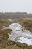 Frozen Path. A frozen slough leading to a farmer's barn Royalty Free Stock Image