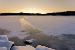 Frozen path leads off to sunset. Royalty Free Stock Photography