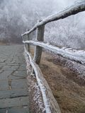 Frozen Pathway. A view down a stone pathway, the handrail/fencing along the rail covered in snow/ice Stock Photography