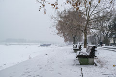 Frozen pathway in the park by the river on a winter day Stock Image