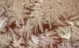 Frozen patterns on a window. Winter nature background. Selective Stock Photos