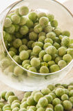 Frozen pea on an old wooden table Stock Photography