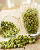 Frozen pea on an old wooden table Royalty Free Stock Image