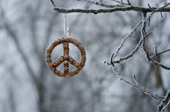 Frozen Peace Sign Hanging Alone in the Winter Forest Royalty Free Stock Photography