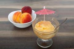 Frozen peach yogurt with with fresh fruits Stock Photo