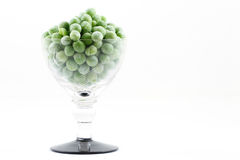 Frozen peas. In small glass Stock Photography